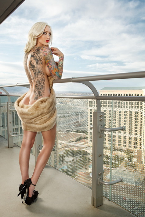 Tattooed model Sabin Kelley, photographed by Photographer Christian Saint, for the 2013 Tattoo Energy Calendar.