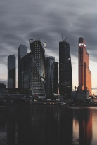 Skyscrapers in Moscow-CIty district at late eveing. They localted at the embankment of Moscow river. The construction process have been constunlty running from 1996 until nowadays. Many international corporates have moved their offices into these buildings.